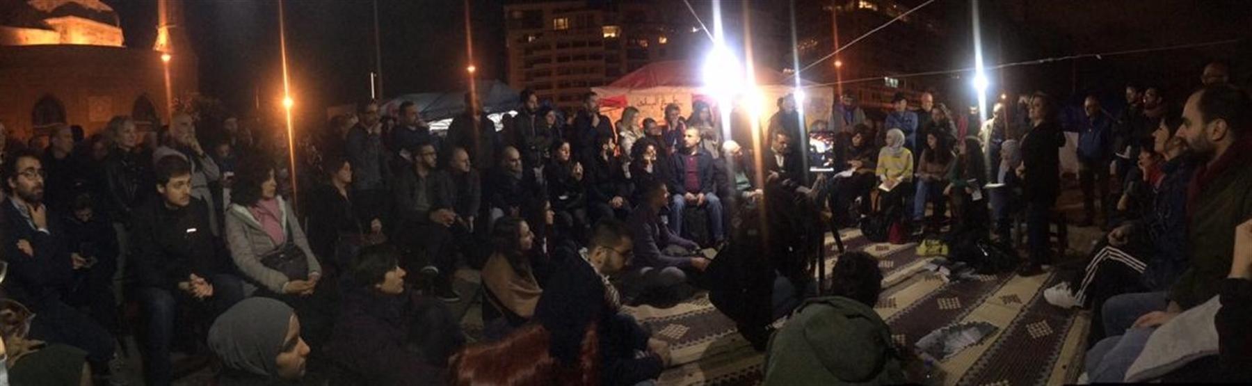 Abir Zaatari, Mona Fawaz, Yara Nahle, and Soha Mneimneh present the lab's work on housing in a public debate organized in the streets by urban activists (Photo Isabela Serhan, December 2019)