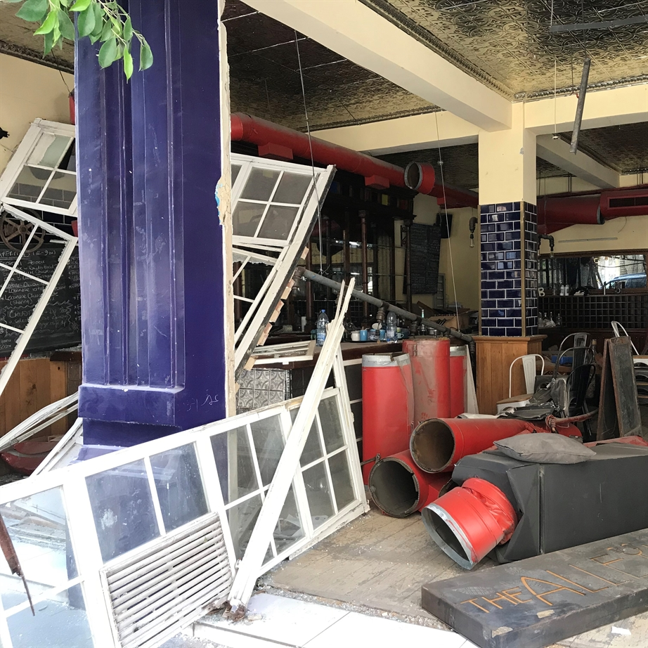 In Mar Mikhael, a café and bookshop is in ruins (Photo: Ahmad Gharbieh)