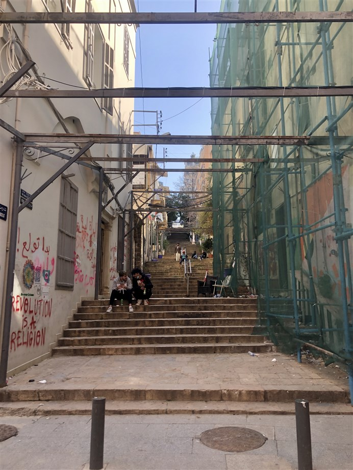 Young people hanging out on the stairs of Gemmayzeh. (Photo: Luna Dayekh)