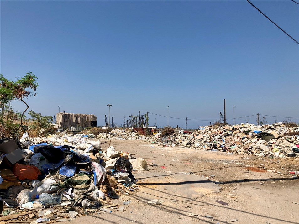 The port and accumulated waste on the sides of the street as seen from Mar Mikhael. (Photo: Luna Dayekh)