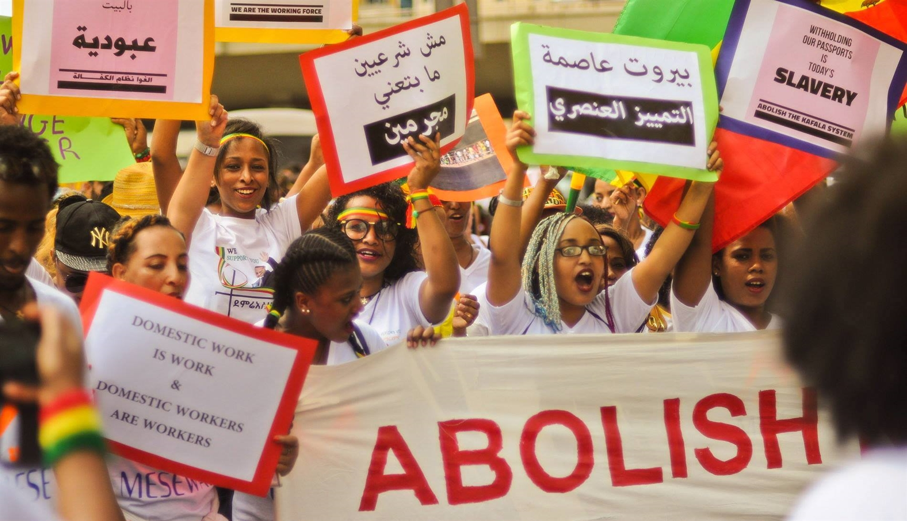 "Potesters call for the abolition of the kafala system at the Domestic Workers' Day protest 2018. One of the signs read: ""Beirut, the capital of racist discrimination"" (Photo: Pat Sy, June 2018, published on Anti-Racism Movement's facebook page)"