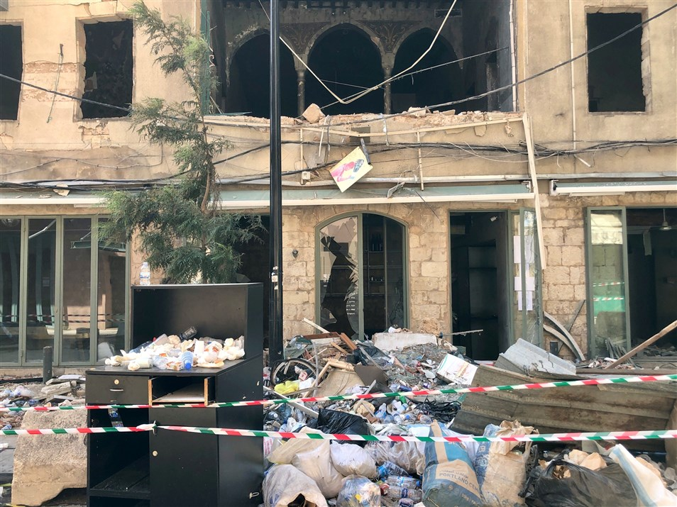 A local business located on the ground floor of a structurally damaged heritage building in Gemmayzeh in the aftermath of the port blast on August 4th. (Photo: Luna Dayekh)